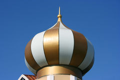 Modern gold dome with white stripes Royalty Free Stock Photo