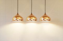 Modern lamp on a background of beige wall royalty free stock photo
