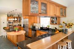 Modern gourmet cherry kitchen. Stock Photos