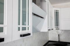 Modern gourmet kitchen interior. Beautiful white design royalty free stock photography
