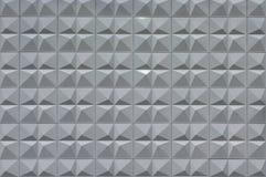 Modern grå vägg av pyramider royaltyfri bild