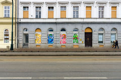 Modern graffiti in the windows of old houses in Prague Stock Images