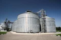 Modern granary. Agro-industry storage technology in animal feed. Factory. Big metal containers for grain storage tanks Royalty Free Stock Photography