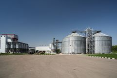 Modern granary in animal feed factory. Agro-industry storage technology. Big metal containers for grain storage. With copyspace stock image