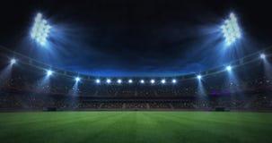 Modern grass field stadium evening floodlight illumination zoom out footage stock video footage