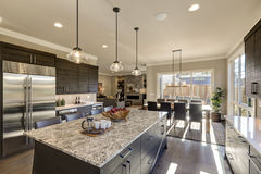 Modern gray kitchen features dark gray cabinetry. Modern gray kitchen features  dark gray cabinetry paired with white quartz countertops and a glossy gray linear Stock Photography