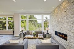 Modern great room with a floor to ceiling stone fireplace Stock Photos
