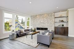 Modern great room with a floor to ceiling stone fireplace Royalty Free Stock Images