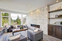 Modern great room with a floor to ceiling stone fireplace Royalty Free Stock Photos
