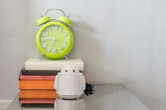 Modern green alarm clock on books Royalty Free Stock Photos