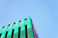 Modern green building against blue skies Stock Images