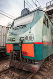 Modern green cargo locomotive with red signs Stock Images