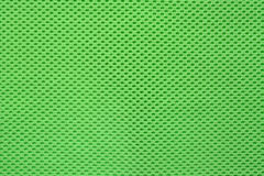 Modern green fabric texture. Abstract modern green perforated cloth texture background Stock Images