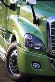 Modern green rig semi truck details like fency big transport Stock Images