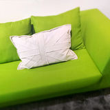 Modern green sofa with white cushion Royalty Free Stock Images