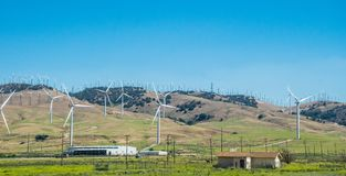 Modern green technologies. Wind Power Station in California. Ecologically clean electricity production. High modern windmills in rural California. A picturesque Stock Photos