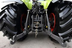Modern green tractor. The rear view Royalty Free Stock Images