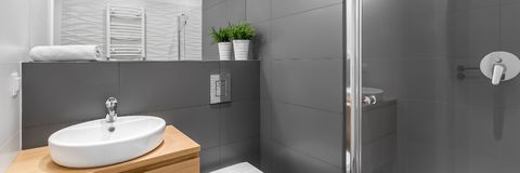 Panorama of modern grey bathroom with shower. Modern grey bathroom with shower, wooden cabinet, round, white basin and toilet, panorama vector illustration