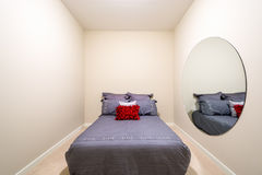 Modern grey bedroom. Interior with red pillow in a luxury house Stock Photography