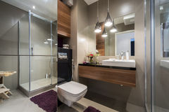Modern grey and beige bathroom Stock Images