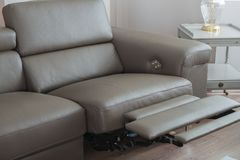 Modern grey leather sofa, with recliner in open position. stock photo