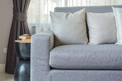 Modern grey sofa with pillows in living room Stock Photos