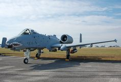 Modern ground attack jet fighter. A-10 Warthog (Thunderbolt) flying gunship on runway Royalty Free Stock Photography