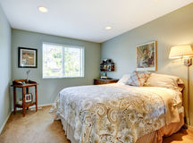 Modern guest bedroom with beige bedding, and carpet. Stock Photos