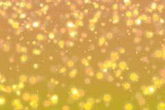Modern guldabstrakt begreppbakgrund med defocused ljus för bokeh Royaltyfri Foto