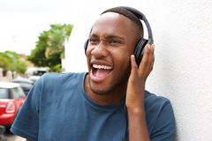 Modern guy listening to music on headphones Royalty Free Stock Photos