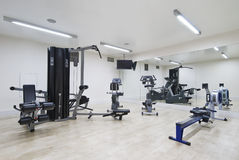 Modern gym. In leisure center with mirror wall and fitness machines Stock Photography