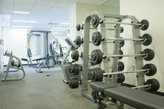 Modern Gym. Modern bright gym with heavy weight lifting equipments Royalty Free Stock Photography