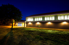 Modern gym building at night royalty free stock images