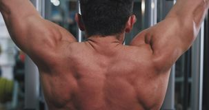 Modern gym class fit man doing workout on his triceps muscles concentrated working hard.  stock footage