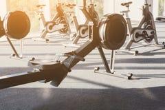 Modern gym interior with equipment, fitness leg exercise machine. Modern gym interior with equipment. Fitness club with row of training leg exercise machines Stock Photo
