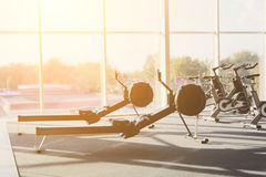 Modern gym interior with equipment, fitness leg exercise machine Stock Image