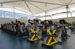 Modern gym interior with equipment Stock Photos