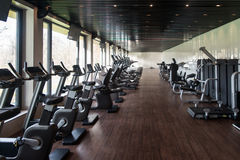 Modern Gym Interior With Equipment Royalty Free Stock Photos