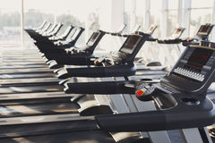 Modern gym interior equipment, treadmill control panels for cardio training Royalty Free Stock Image