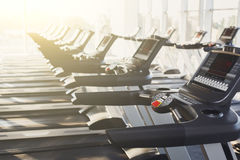 Modern gym interior equipment, treadmill control panels for cardio training Royalty Free Stock Images