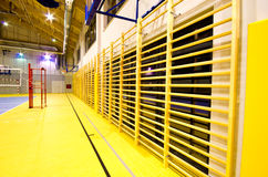 Modern gym interior. Interior of a new modern gym at night. A side wall with windows and wooden ladders Stock Photo
