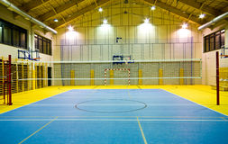 Modern gym interior. Interior of a new modern gym at night. Yellow and blue design elements. Spacious interior wide angle view Royalty Free Stock Image