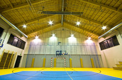 Modern gym interior. Interior of a new modern gym at night. Yellow and blue design elements. Spacious interior wide angle view Stock Photography