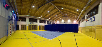 Modern gym interior. Interior of a new modern gym at night. Yellow and blue design elements. Spacious interior wide angle view Stock Photo