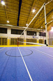 Modern gym interior. Interior of a new modern gym at night. Yellow and blue design elements. Spacious interior wide angle view. Volleyball net detail stock photo