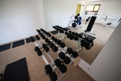 Modern gym interior with various equipment. Empty gym and workout equipment for legs, hands etc Stock Photography