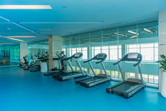 Modern gym with various sports equipment Stock Photos