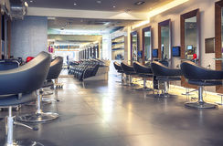 Modern hair salon. Interior of modern hair salon stock images