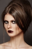 Modern hairstyle on luxury model, fashion make-up stock image