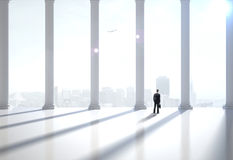 Modern hall. Businessman in suit in the modern hall Royalty Free Stock Photo
